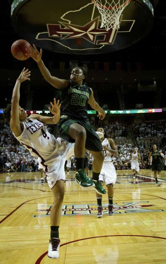 Baylor guard Terran Condrey (20) fouls Texas A&M guard Sydney Carter (4) during the first half of a NCAA women's basketball game at Reed Arena on Monday, Feb. 27, 2012, in College Station. Photo: Smiley N. Pool, Houston Chronicle / © 2012  Houston Chronicle