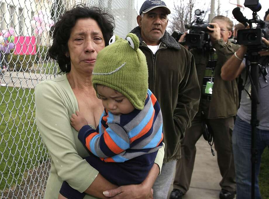 Silvia Mancia,  grandmother of elementary school student Joanna Ramos,10, who died after a fight with another student on Friday Feb. 24,2012  arrives at a makeshift memorial at the Willard Elementary School in Long Beach, Calif. on Monday Feb. 27, 2012.  The Los Angeles County coroner's office has ruled that the death of a 10-year-old Southern California schoolgirl after a fight was a homicide.  (AP Photo/Nick Ut) Photo: Nick Ut, Associated Press
