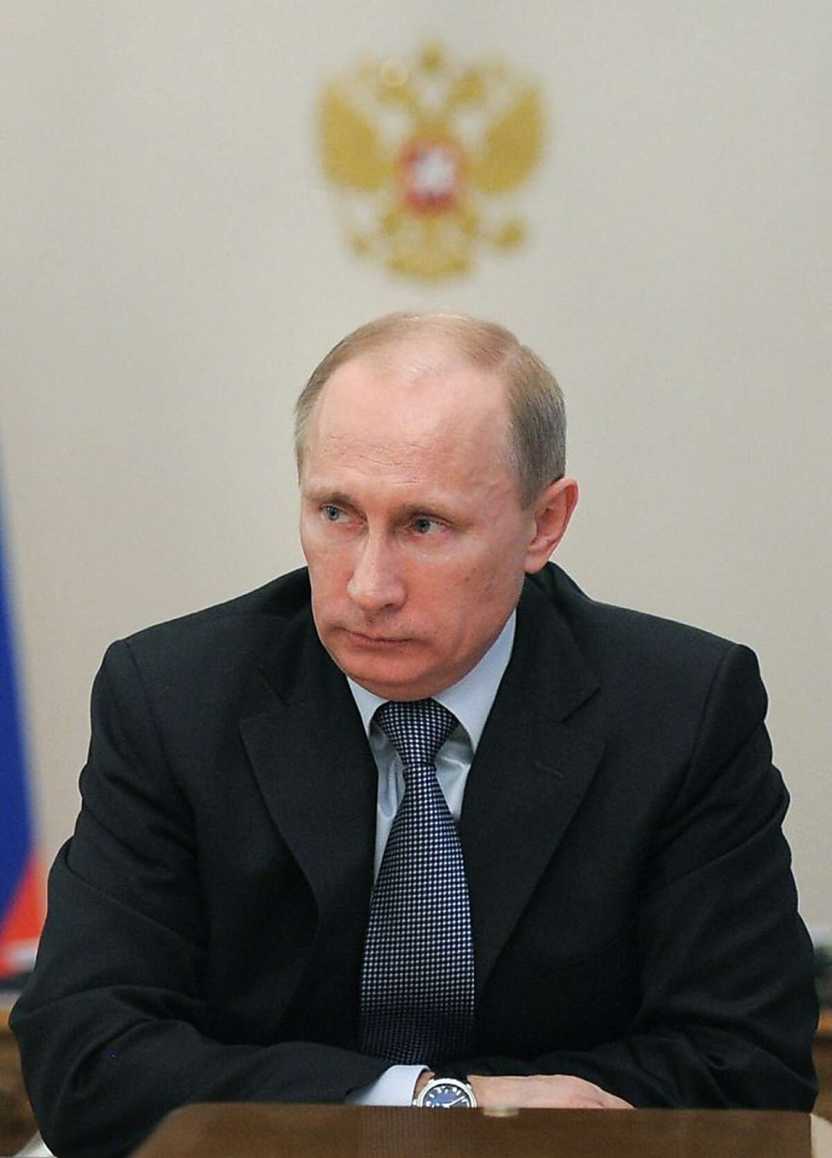 Russian Prime Minister Vladimir Putin speaks during the meeting of military-technical cooperation in the Novo-Ogaryovo residence outside Moscow, Monday, Feb. 27, 2012. Putin warned against military intervention in Syria or an attack on Iran in scathing criticism of the West on Monday as he laid out his foreign policy priorities ahead of Russia's presidential vote. In Monday's article, Putin again criticized the U.S.-led plans for a NATO missile defense system in Europe, saying it's aimed against Russian nuclear forces. (AP Photo/RIA Novosti, Alexei Druzhinin, Government Press Service)