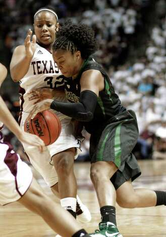Baylor's Odyssey Sims, right, pushes her way past Texas A&M's Adrienne Pratcher (32) in the second half of an NCAA college basketball game Monday, Feb. 27, 2012, in College Station. Baylor won 69-62. Photo: Associated Press