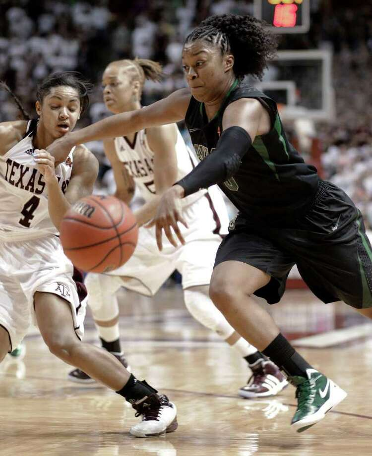 Baylor's Odyssey Sims, right, makes contact with Texas A&M's Sydney Carter (4) in the second half of an NCAA college basketball game Monday, Feb. 27, 2012, in College Station. Baylor won 69-62. Photo: Associated Press