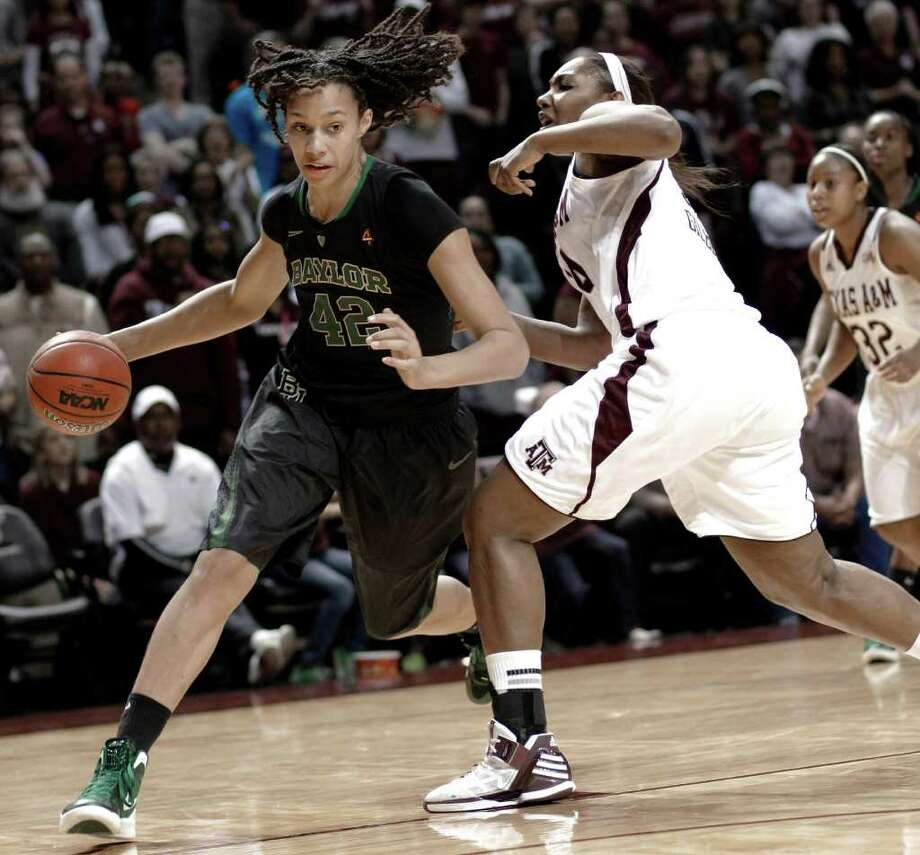 Baylor's Brittney Griner (42) drives past Texas A&M's Karla Gilbert during the second half of an NCAA college basketball game Monday, Feb. 27, 2012, in College Station. Baylor won 69-62. Photo: Associated Press