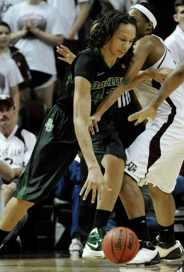 Baylor's Brittney Griner, left, pushes against Texas A&M's Kelsey Bone in the first half of an NCAA college basketball game Monday, Feb. 27, 2012, in College Station. Photo: Associated Press