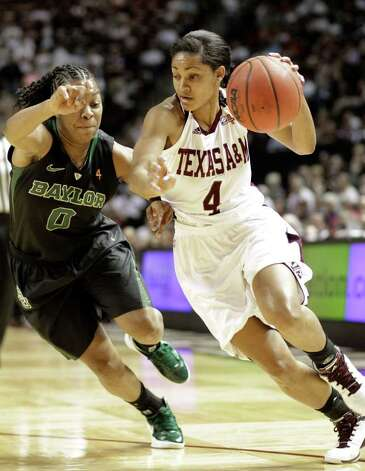 Texas A&M's Sydney Carter (4) tries to drive past Baylor's Odyssey Sims (0) during the first half of an NCAA college basketball game Monday, Feb. 27, 2012, in College Station. Photo: Associated Press