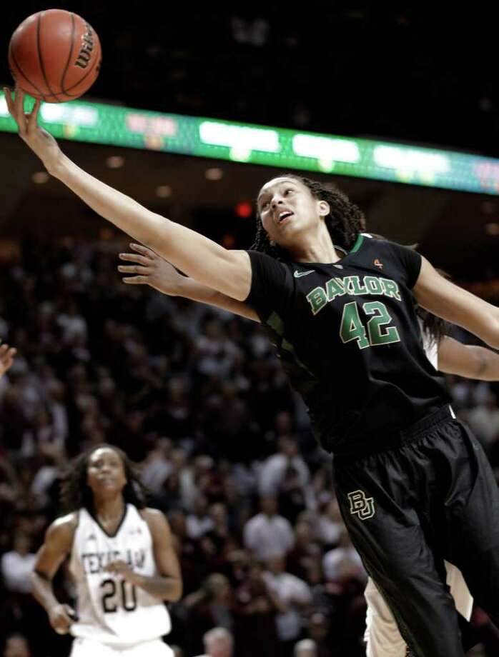 Baylor's Brittney Griner (42) grabs a rebound in the final minutes against Texas A&M in an NCAA college basketball game Monday, Feb. 27, 2012, in College Station. Baylor won 69-62. Photo: Associated Press