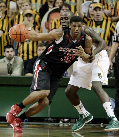 Texas Tech 's Jordan Tolbert (32) drives against Baylor 's Quincy Acy (4) in the second half of an NCAA college basketball game Monday, Feb. 27, 2012, in Waco. Tolbert had a gam-high 19-points in the 77-48 loss to Baylor. Photo: Associated Press