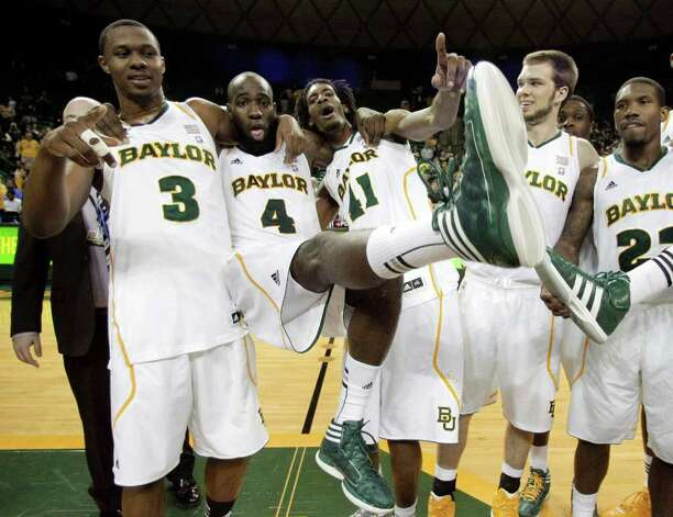 Baylor 's Fred Ellis (3), Quincy Acy (4) and Anthony Jones (41) celebrate with Jacob Neubert, second from right, and A.J. Walton (22) following an NCAA college basketball game against Texas Tech Monday, Feb. 27, 2012, in Waco. Ellis, Acy and Jones, graduating seniors, played their final home game for Baylor in the 77-48 win. Photo: Associated Press
