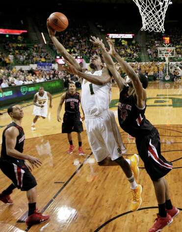 Baylor 's Perry Jones III (1) attempts a shot over Texas Tech 's Jordan Tolbert, right, as Ty Nurse, left,  and Javarez Willis (5) look on in the second half of an NCAA college basketball game Monday, Feb. 27, 2012, in Waco. Jones III had 15 points and 10 rebounds in the 77-48 Baylor win. Photo: Associated Press