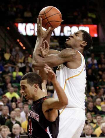 Baylor forward Perry Jones III (1) is fouled attempting a shot by Texas Tech 's Ty Nurse, bottom, in the second half of an NCAA college basketball game Monday, Feb. 27, 2012, in Waco. Jones III had 15 points and 10 rebounds in the 77-48 Baylor win. Photo: Associated Press