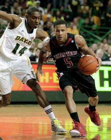 Texas Tech 's Javarez Willis (5) drives past Baylor 's Deuce Bello (14) in the first half of an NCAA college basketball game Monday, Feb. 27, 2012, in Waco. Photo: Associated Press
