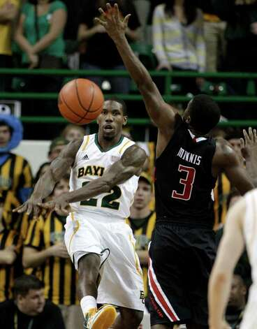 Baylor guard A.J. Walton (22) passes the ball as Texas Tech 's DeShon Minnis (3) defends in the first half of an NCAA college basketball game Monday, Feb. 27, 2012, in Waco. Photo: Associated Press
