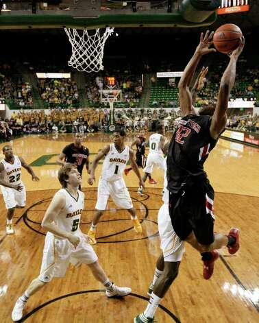 Texas Tech 's Jordan Tolbert (32) goes up for a dunk attempt past Baylor 's Quincy Acy, right rear, and Baylor 's Brady Heslip (5) in the first half of an NCAA college basketball game Monday, Feb. 27, 2012, in Waco. Photo: Associated Press