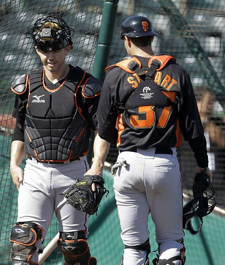 San Francisco Giants' Eli Whiteside, left, walks past fellow catcher Chris Stewartduring a spring training baseball workout on Sunday, Feb. 26, 2012, in Scottsdale, Ariz. (AP Photo/Darron Cummings) Photo: Darron Cummings, Associated Press
