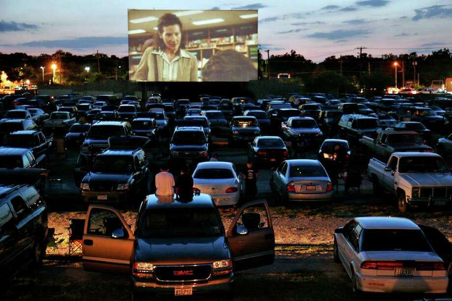 '1408' plays at the Mission Drive-In, Friday, August 24, 2007. The drive-in re-opened after being vandalized earlier this year. The movie theater opened in March 1948 and is a South Side landmark.  Photo: NICOLE FRUGE, SAN ANTONIO EXPRESS-NEWS / SAN ANTONIO EXPRESS-NEWS