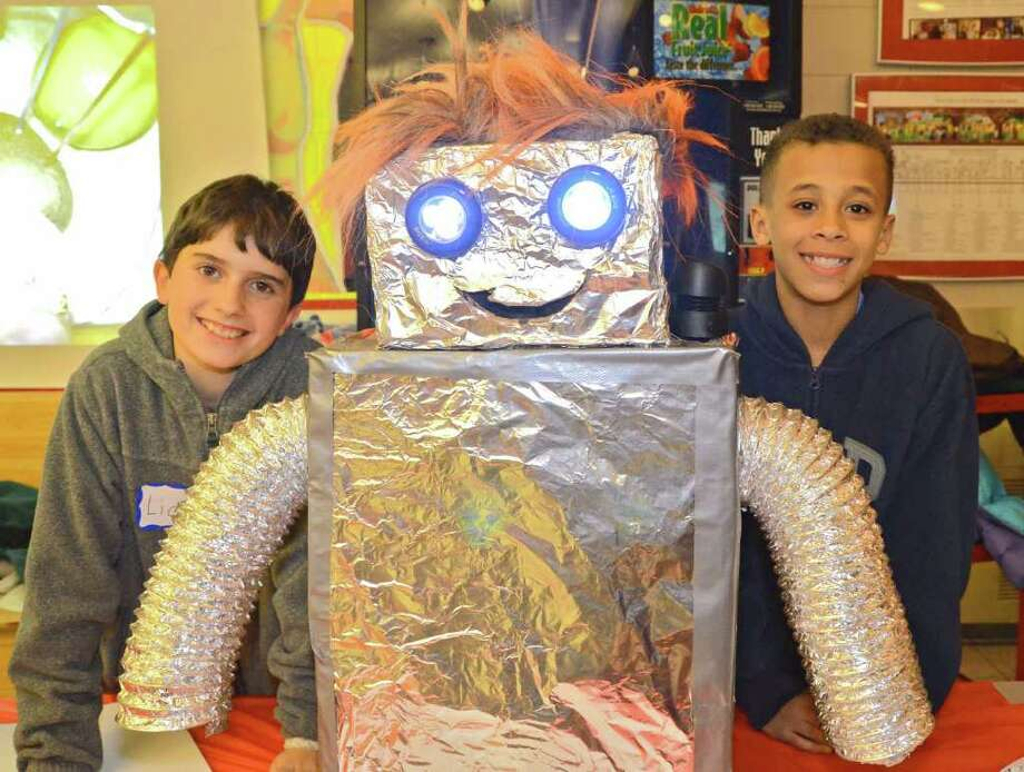 """Fifth graders Liam O'Neill and Luke Rwambuya with their creation, """"Dr. Roboto,"""" during the New Canaan Public Schools 6th Annual Tech Night at NCHS, Thursday night, Feb. 23, 2012. Photo: Jeanna Petersen Shepard"""