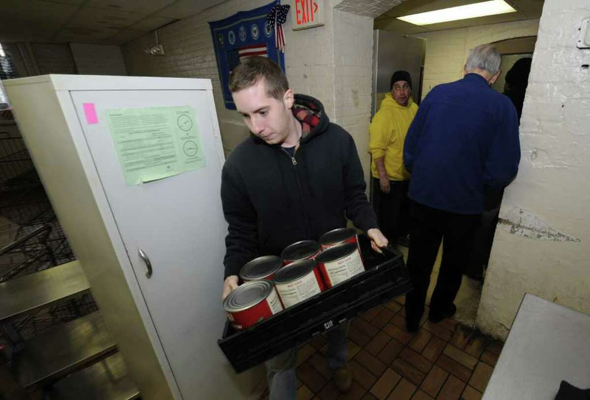 A volunteer moves food stuffs from the old Blessed Sacrament Community Kitchen at the corner of Central and Lake Avenue to waiting vehicles for transport to the new soup kitchen at the Sister Maureen Joyce Center in Albany, N.Y. Feb. 28, 2012. ( Skip Dickstein / Times Union)