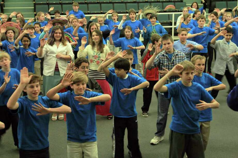 MMS seventh-graders dance the day away during Latin America Day. Photo: Contributed Photo