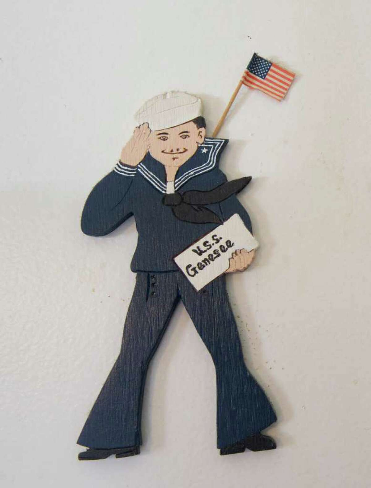 A carving hangs on the wall in World War II veteran Clement Bellairs' home in Stamford, Conn., February 26, 2012.