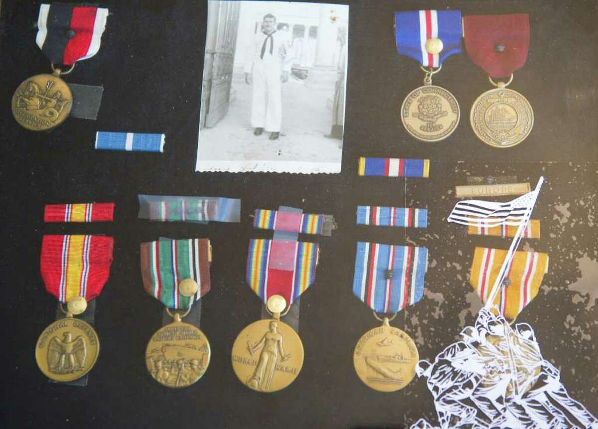 World War II veteran Clement Bellairs' medals from his years of service on display in his home in Stamford, Conn., February 26, 2012.