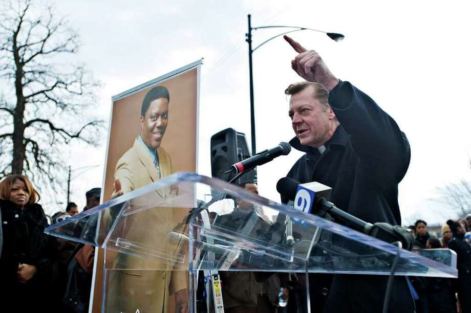 Father Michael Pfleger talks to the crowd. Photo: Timothy Hiatt, Getty Images / 2012 Getty Images
