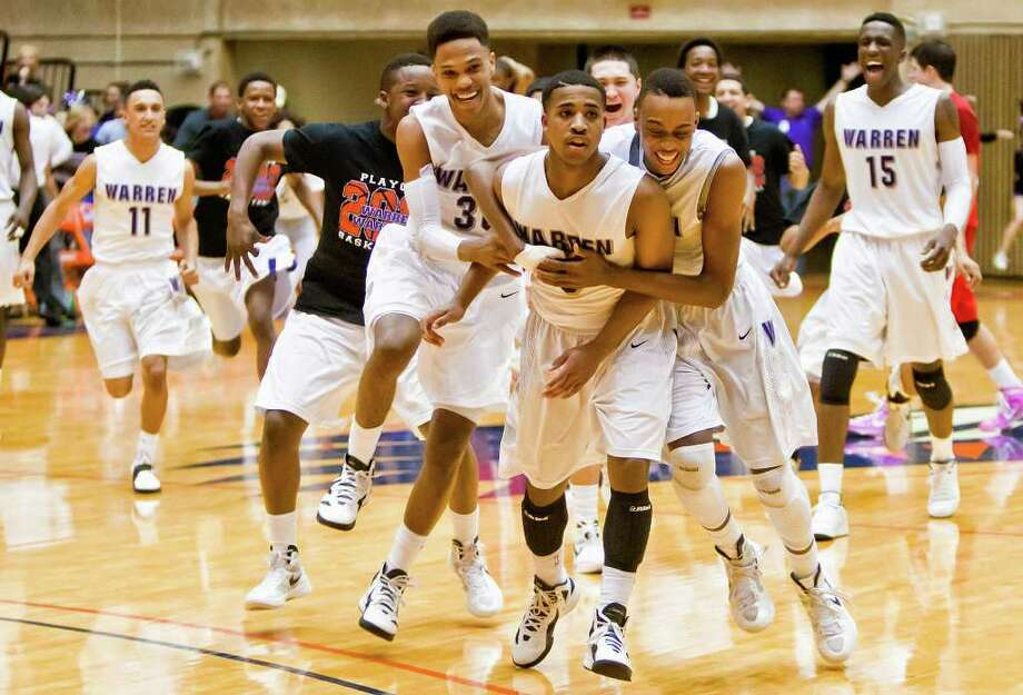 Warren's Marcus Keene (center), who has a reputation for clutch shots, sunk Judson in the third round with an OT buzzer-beater. Photo: MARVIN PFEIFFER, Marvin Pfeiffer / Prime Time Newspapers / Prime Time Newspapers 2012