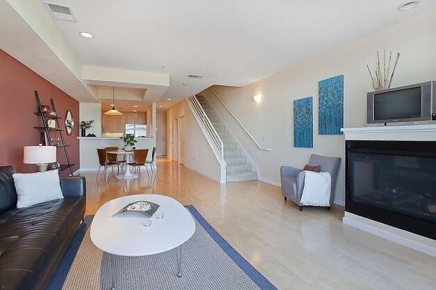 The main living space is open. The 1,243-square-foot home has high ceilings. Photo: OpenHomesPhotography.com