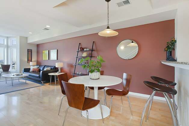 The dining area shares an open space with the living room. Photo: OpenHomesPhotography.com