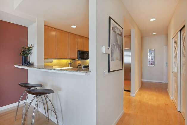 The kitchen boasts a breakfast bar that connects to the dining space. Photo: OpenHomesPhotography.com