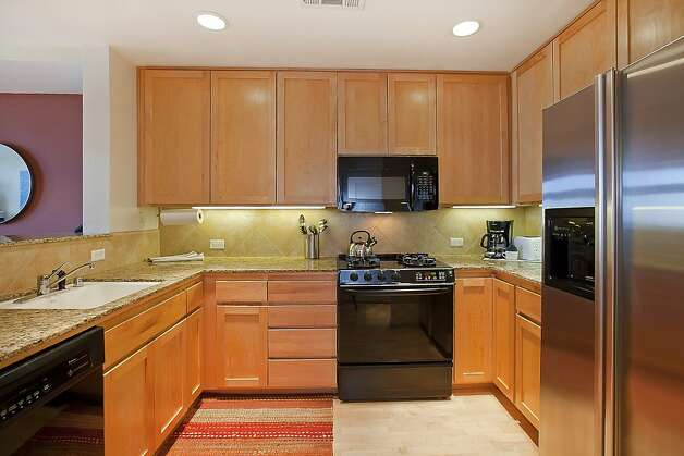 Stainless steel appliances and granite countertops are a highlight of the kitchen. Photo: OpenHomesPhotography.com