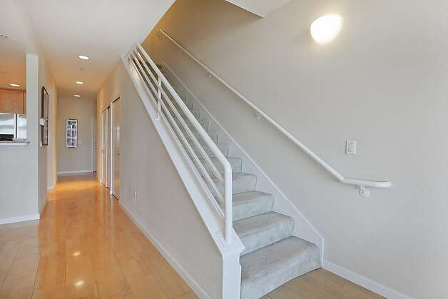 Stairs from the main living area lead to the bedrooms. Photo: OpenHomesPhotography.com