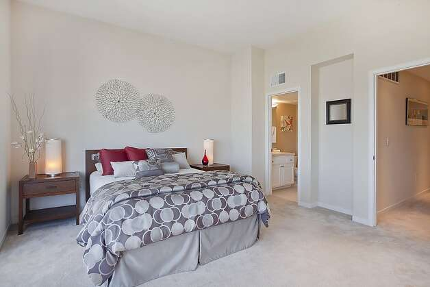 Another look at the master bedroom and adjacent bathroom. Photo: OpenHomesPhotography.com