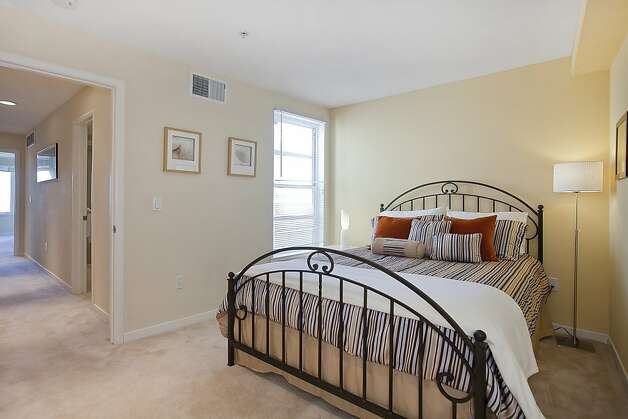 On the second level, a wide hallway connects one bedroom to the other. Photo: OpenHomesPhotography.com