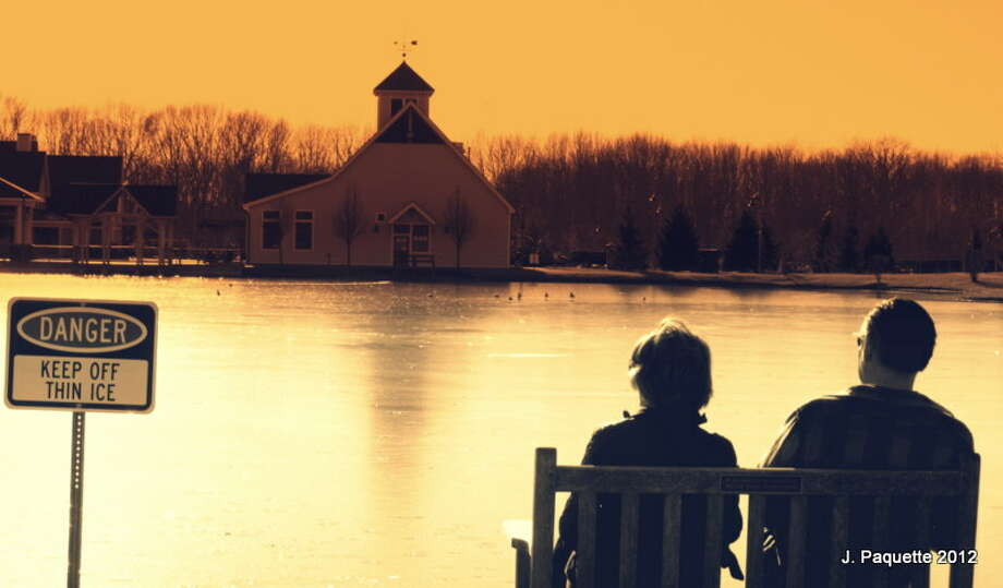 A couple sits by the pond at The Crossing Of Colonie on Monday January 6 2012 as temperatures were unseasonably warm. (Justin Paquette, Colonie) Photo: Picasa