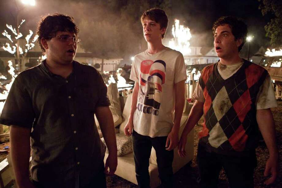 "In this film image released by Warner Bros., from left, Jonathan Daniel Brown, Thomas Mann and Oliver Cooper are shown in a scene from ""Project X."" Photo: AP"