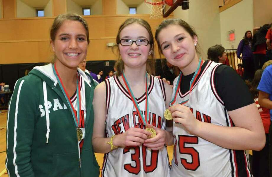 Hannah Femia, Julia Simpson and Raven Killinger, all New Canaanites, participated in the Unified Sports Basketball Tournament at St. Luke's School, Monday, Feb. 27, 2012. Photo: Jeanna Petersen Shepard