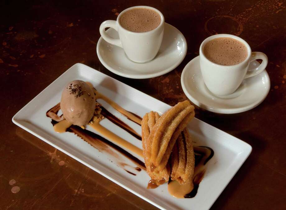 Churros rellenos stuffed with dulce de leche and served with chocolate ice cream and Mexican hot chocolate at Hugo's Photo: Steve Campbell / Houston Chronicle