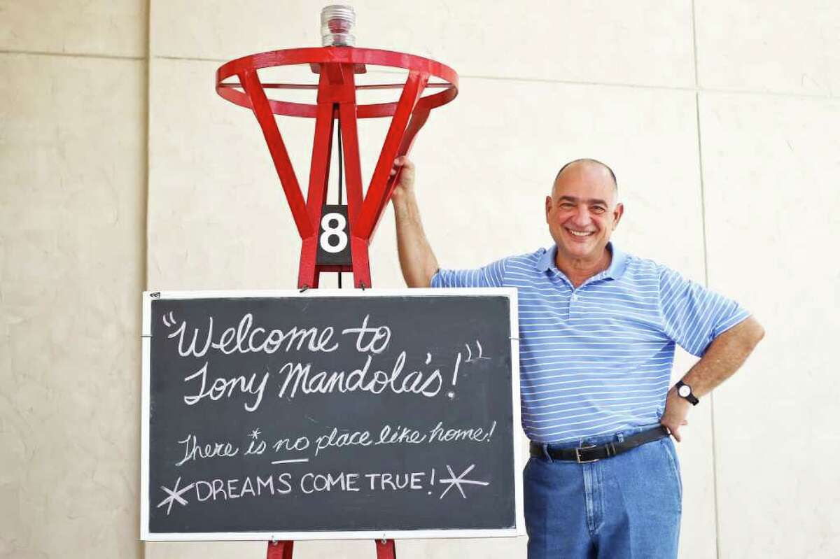 Tony Mandola stands next to the exterior welcome sign at the new Tony Mandola's restaurant on Waugh near West Dallas, Friday, July 1, 2011, in Houston. Tony Mandola's was on West Gray for about 25 years, but has recently moved and built a stand-alone building much larger than the previous restaurant and built from the ground up to begin a new chapter in the history of Tony Mandola's. ( Michael Paulsen / Houston Chronicle )