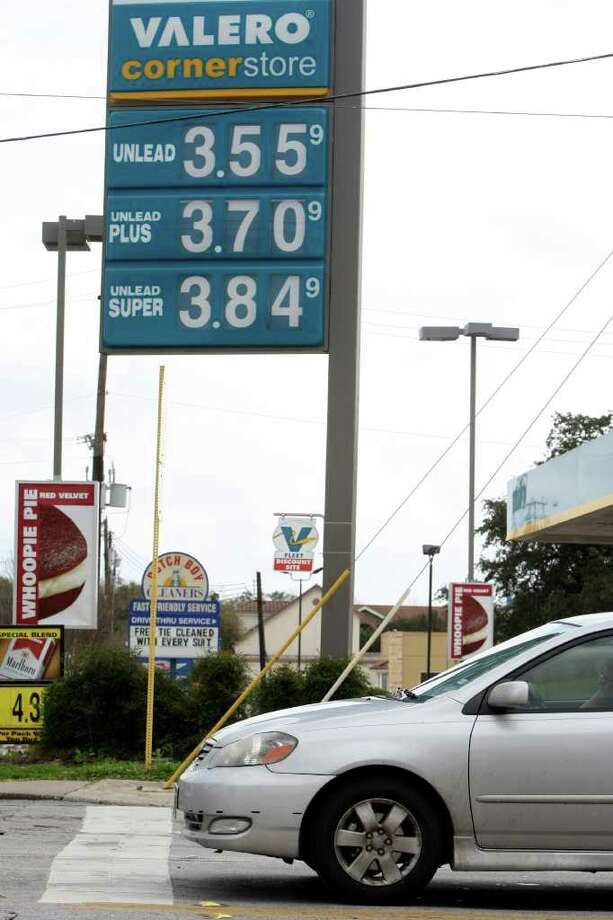 A sign at a Valero Corner Store displays unleaded gasoline at $3.55. Photo: HELEN L. MONTOYA, San Antonio Express-News / ©2012 San Antonio Express-News