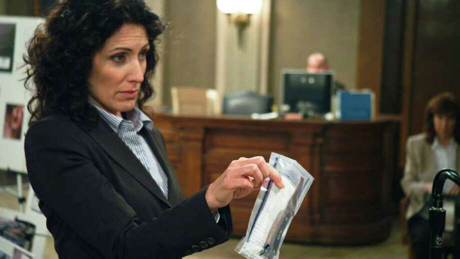 Lisa Edelstein stars as  Kelly Siegler  in the new Lifetime Original Movie Blue-Eyed Butcher, premiereing Saturday, March 3, at 8pm ET/PT on Lifetime.   2011 A&E Television Networks, LLC. All rights reserved.  Photo Credit: Jack Zeman Photo: Jack Zeman
