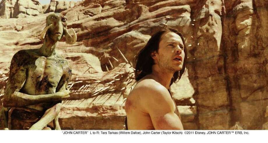 "L to R: Tars Tarkas (Willem Dafoe), John Carter (Taylor Kitsch) in a scene from the movie ""John Carter."" Photo: Walt Disney Films / ©2011 Disney. JOHN CARTER™ ERB, Inc."