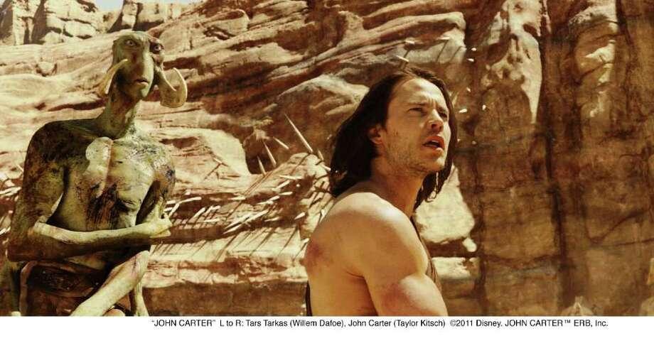 "L to R: Tars Tarkas (Willem Dafoe), John Carter (Taylor Kitsch) in a scene from the movie ""John Carter."" Photo: Walt Disney Films / ©2011 Disney. JOHN CARTER™ ERB, Inc."