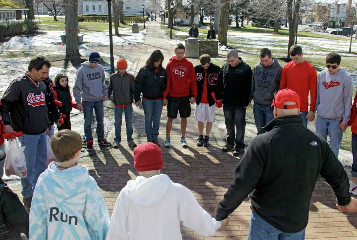 Students and parents pray for the victims of the school shooting in Chardon, Ohio, on Tuesday. Three of those who died were students at Chardon High School.