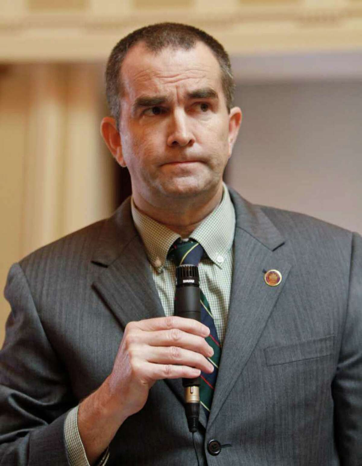 State Sen. Ralph Northam, D-Norfolk, the senate's only doctor, grimaces as he speaks during debate on a bill requiring an ultrasound before an abortion on the floor of the Senate at the Capitol in Richmond, Va., Tuesday, Feb. 28, 2012. (AP Photo/Steve Helber)
