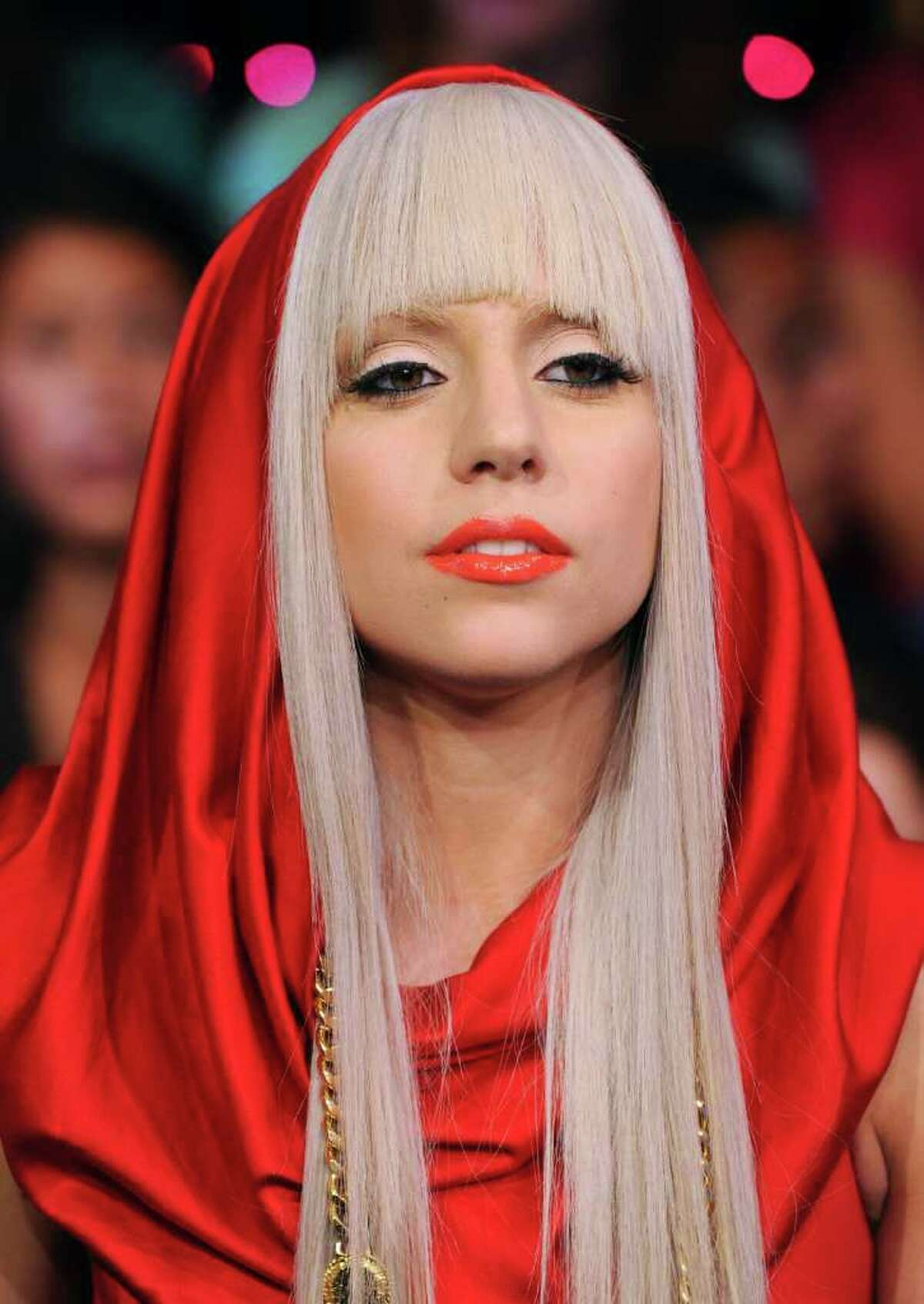 """FILE - In this Aug. 12, 2008 photo Lady Gaga makes an appearance at MTV Studio's in Times Square for MTV's """"Total Request Live"""" show in New York. Nearly a century after a ?secret court? at Harvard University expelled seven students for being gay _ or being perceived as gay _ students and faculty members are urging administrators to award them posthumous degrees. A group of students and faculty members are planning a rally at the university Wednesday during a campus visit by Lady Gaga, who will be at Harvard to launch her Born This Way anti-bullying foundation. (AP Photo/Peter Kramer, File)"""