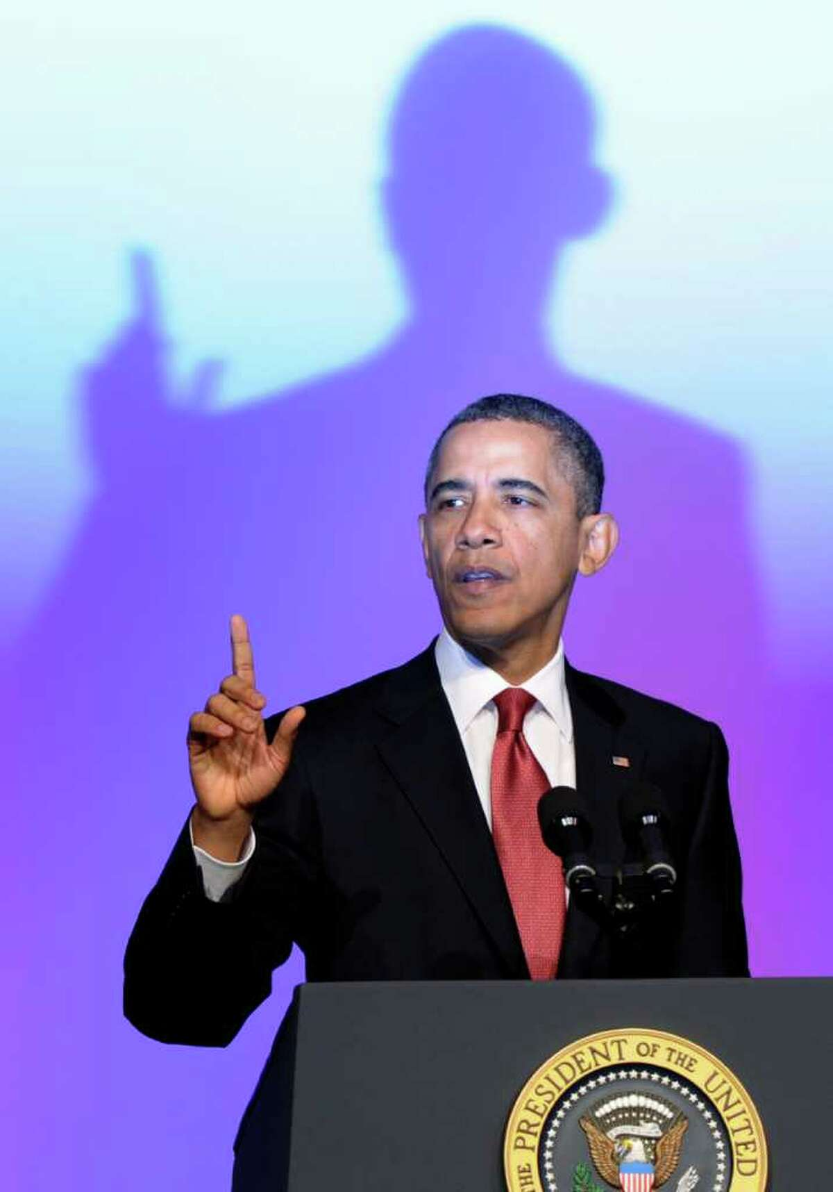 President Barack Obama defends the bailout of the auto industry Tuesday at a union conference.