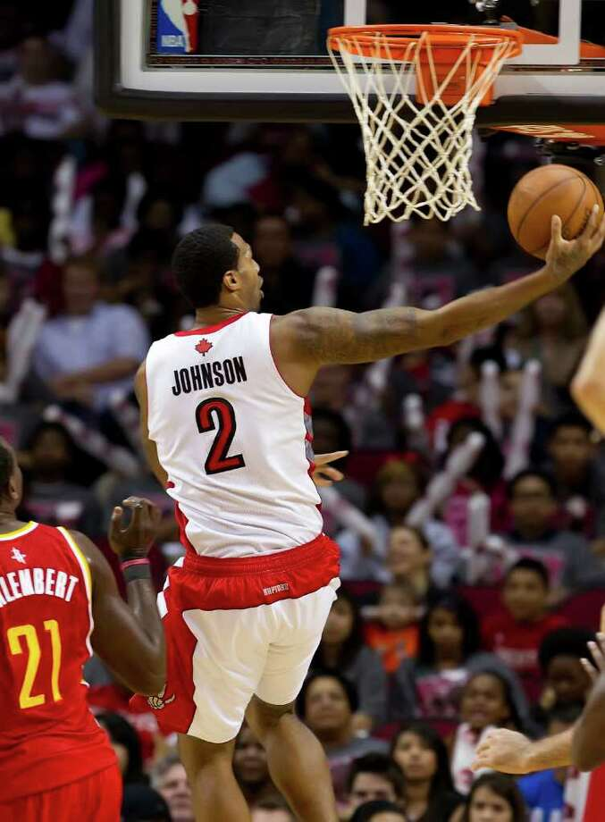 James Johnson (2) of the Toronto Raptors lays in a shot against the Houston Rockets on Tuesday, February 28, 2012, in Houston, Texas. (George Bridges/MCT) Photo: George Bridges, McClatchy-Tribune News Service / MCT
