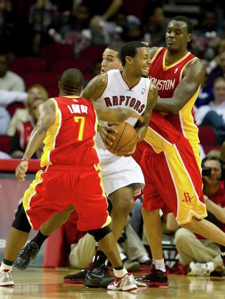 James Johnson (2) of the Toronto Raptors is caught up in the defense of the Houston Rockets on Tuesd