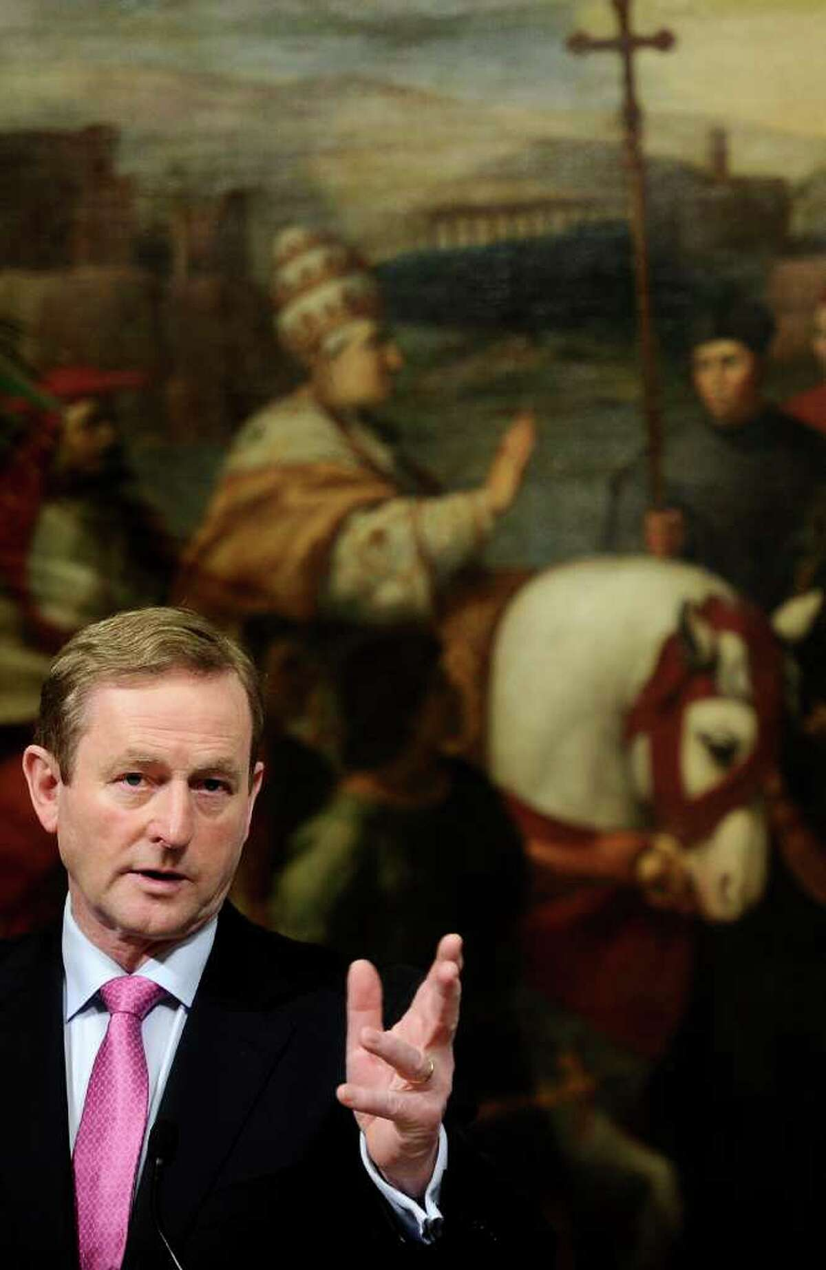 Ireland's Prime Minister Enda Kenny gestures during a joint press conference with his Italian counterpart after their meeting at Palazzo Chigi in Rome on February 23, 2012. AFP PHOTO / FILIPPO MONTEFORTE (Photo credit should read FILIPPO MONTEFORTE/AFP/Getty Images)
