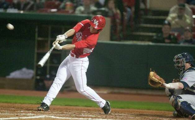 University of Houston designated hitter Zach Gibson (29) hits a RBI single to center to knock in teammate Casey Grayson (43) during the fourth inning of a NCAA college baseball game against Rice at Cougar Field on Tuesday February 28, 2012 in Houston, TX. Photo: J. Patric Schneider, For The Chronicle / Houston Chronicle