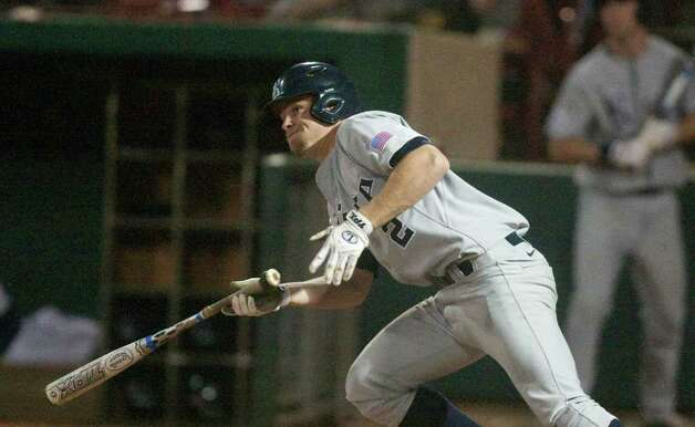 Rice third baseman Shane Hoelscher (2) hits a RBI single to knock in teammate Michael Ratterree (8) during the fifth inning of a NCAA college baseball game against the University of Houston at Cougar Field on Tuesday February 28, 2012 in Houston, TX. Photo: J. Patric Schneider, For The Chronicle / Houston Chronicle